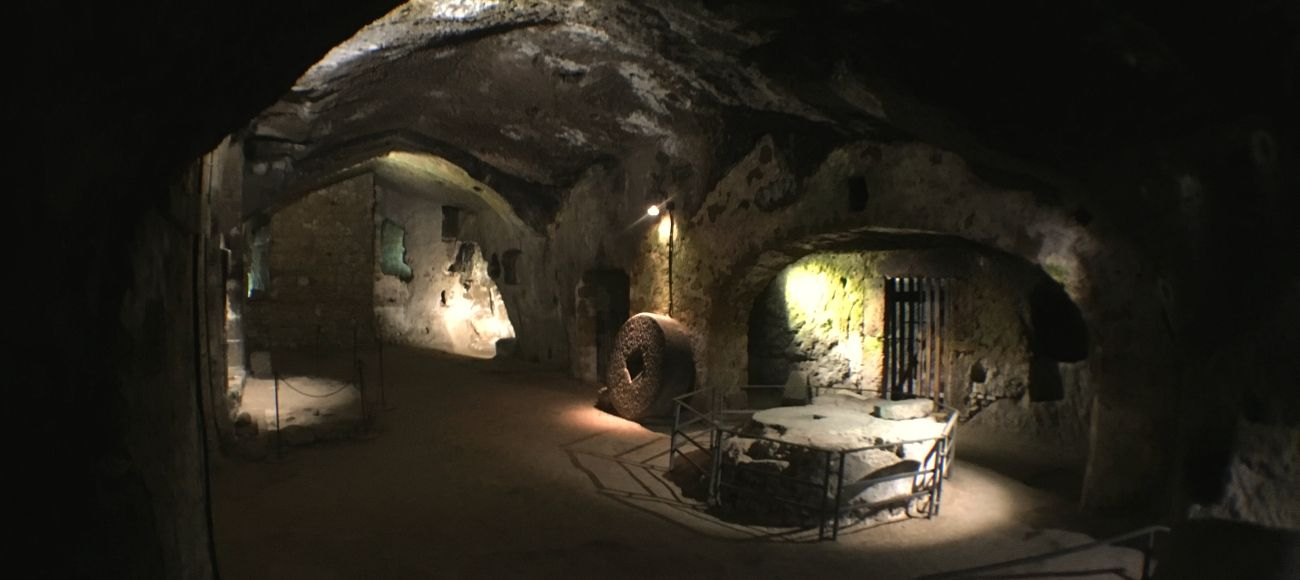 orvieto underground cellars made in sandstone. visit orvieto on a transfer tour from florence to naples and amalfi coast or positano